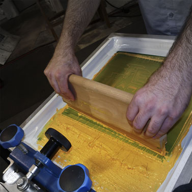 close up of screen printing process